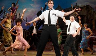 "Andrew Rannells (center) performs in ""The Book of Mormon"" at the Eugene O'Neill Theatre in New York. The show won nine Tony Awards in June, including Best Musical, and remains the hottest ticket on Broadway. Between the stage and politics this year, Mormons are ""becoming stronger, not necessarily in their numbers but in their visibility,"" said Jan Shipps, the pre-eminent non-Mormon expert on the church. (Associated Press)"