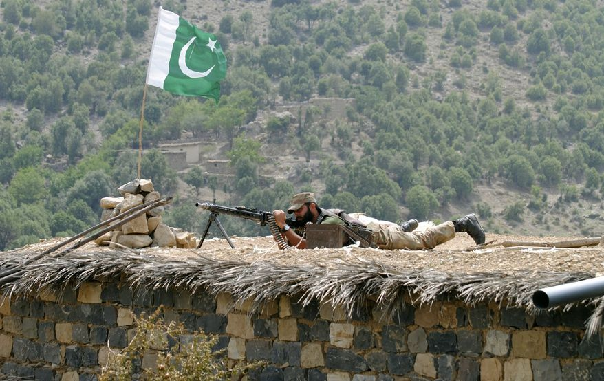 A Pakistani soldier takes a position during a military operation against militants in Pakistan's Khurram tribal region on Sunday, July 10, 2011. (AP Photo/Mohammad Zubair)