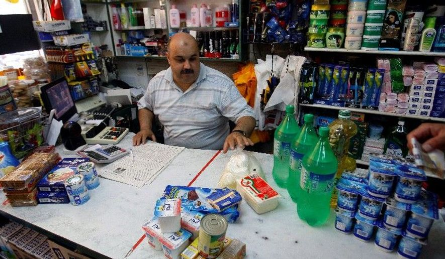 Maher Khoudari's grocery store in Gaza is well-stocked a year after Israel eased its blockade of the Hamas-ruled area, ending acute shortages of food and household goods. High unemployment and heavy reliance on food handouts, however, mean nonessentials such as fancy chocolates go unbought. (Associated Press)