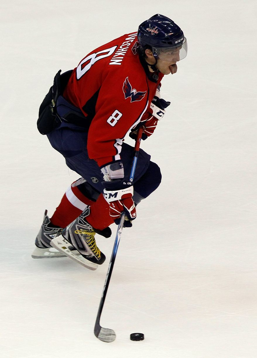 Washington Capitals left wing Alex Ovechkin, from Russia, looks to shoot the puck in the second period of Game 1 of a first-round NHL hockey playoff series with the New York Rangers Wednesday, April 13, 2011 in Washington.(AP Photo/Alex Brandon)