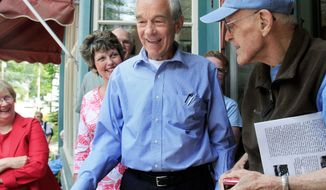 ** FILE ** Rep. Ron Paul, Texas Republican on the campaign trail in Freedom, N.H. (Associated Press)