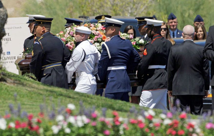 A military honor guard carries the casket of former first lady Betty Ford to her funeral at St. Margaret's Episcopal Church in Palm Desert, Calif., Tuesday, July 12, 2011. (AP Photo/Reed Saxon)