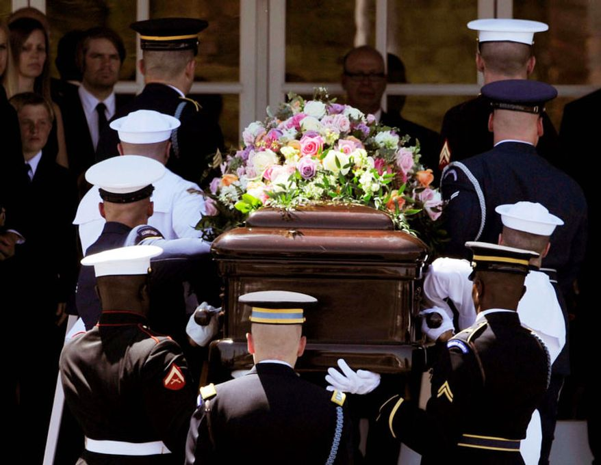 A military honor guard carries the casket of former first lady Betty Ford into her funeral at St. Margaret's Episcopal Church in Palm Desert, Calif., Tuesday, July 12, 2011. (AP Photo/Chris Pizzello)