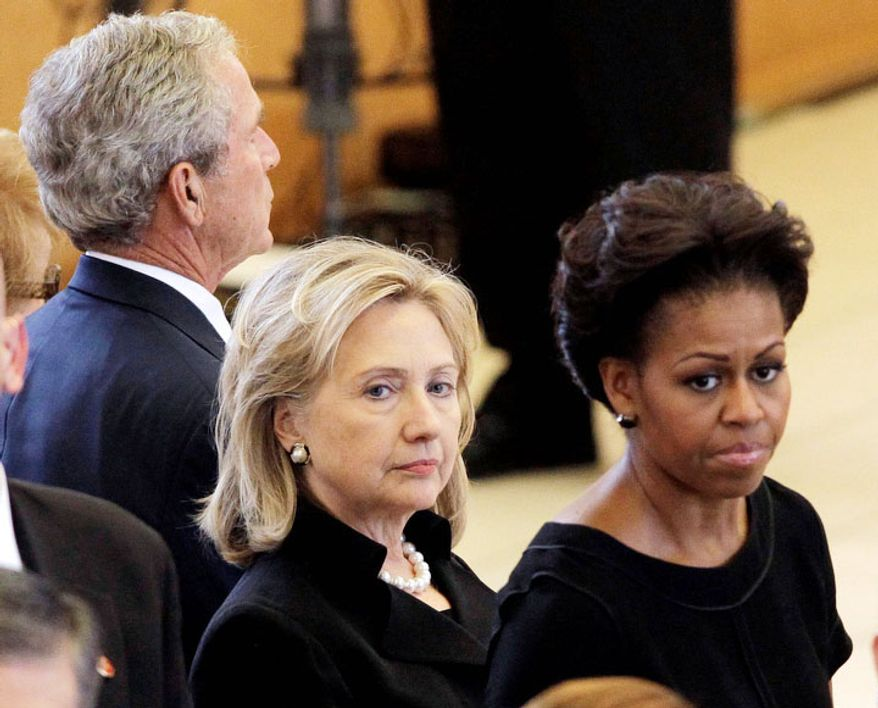 Secretary of State Hillary Rodham Clinton, center, and first lady Michelle Obama stand together during the funeral for former first lady Betty Ford at St. Margaret's Episcopal Church Tuesday, July 12, 2011, in Palm Desert, Calif. Former President George W. Bush is at back. (AP Photo/Jae C. Hong, Pool) ** FILE **