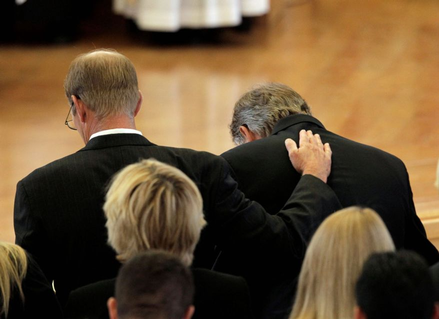 Steve Ford, left, comforts his brother Jack during the funeral for their mother, former first lady Betty Ford at St. Margaret's Episcopal Church Tuesday, July 12, 2011, in Palm Desert, Calif.  (AP Photo/Jae C. Hong, Pool)