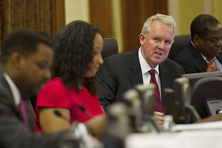 Tommy Wells, Ward 6 Councilmember, speaks during a legislative session at the John A. Wilson Building, in Washington, D.C., Tuesday, July 12, 2011. Council Chair Kwame Brown stripped Wells of his chairmanship of the Committee on Public Works and Transportation (Drew Angerer/The Washington Times)