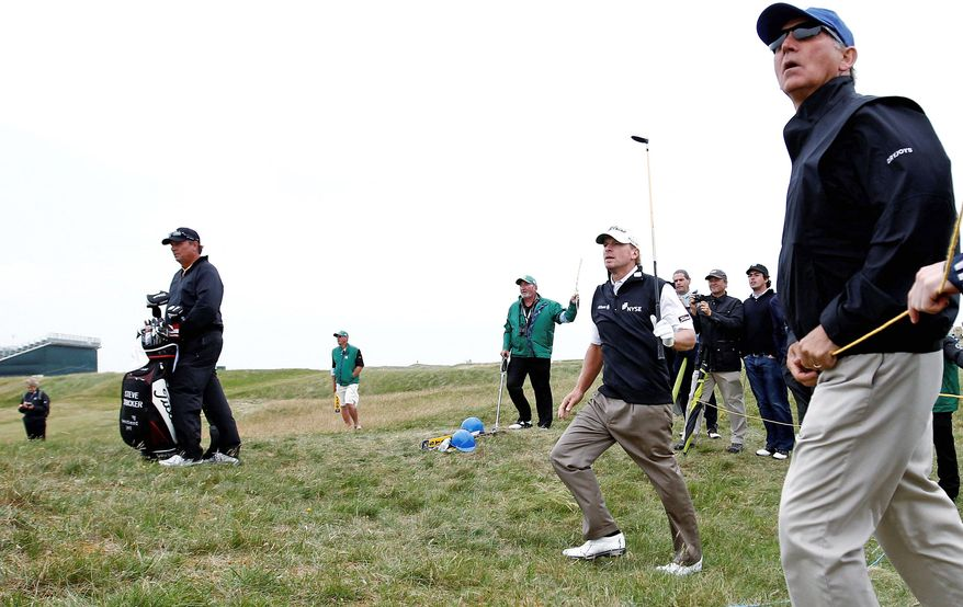 ASSOCIATED PRESS Steve Stricker watches his shot on the ninth fairway during a practice round ahead of the British Open at Royal St. George's.
