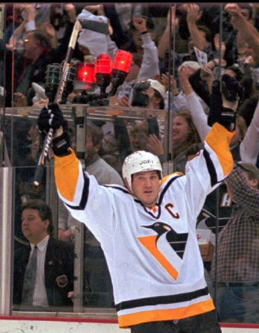 Pittsburgh Penguins Mario Lemieux celebrates his 600th career goal, a third period empty net goal that helped beat the Vancouver Canucks, 6-4, Tuesday Feb. 4, 1997, in Pittsburgh.(AP Photo/Gene J. Puskar)