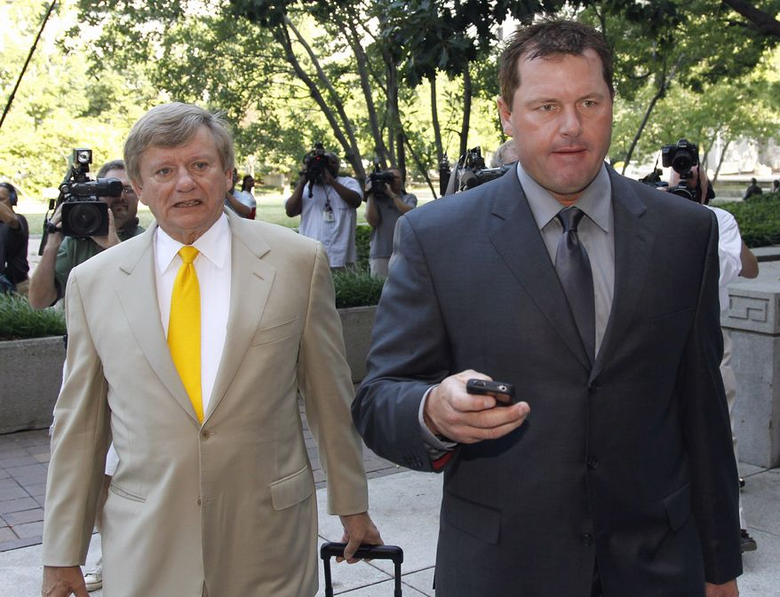 Former Major League Baseball pitcher Roger Clemens (right) and his attorney Rusty Hardin arrive at federal court in Washington on July 13, 2011, for his perjury trial. (Associated Press)