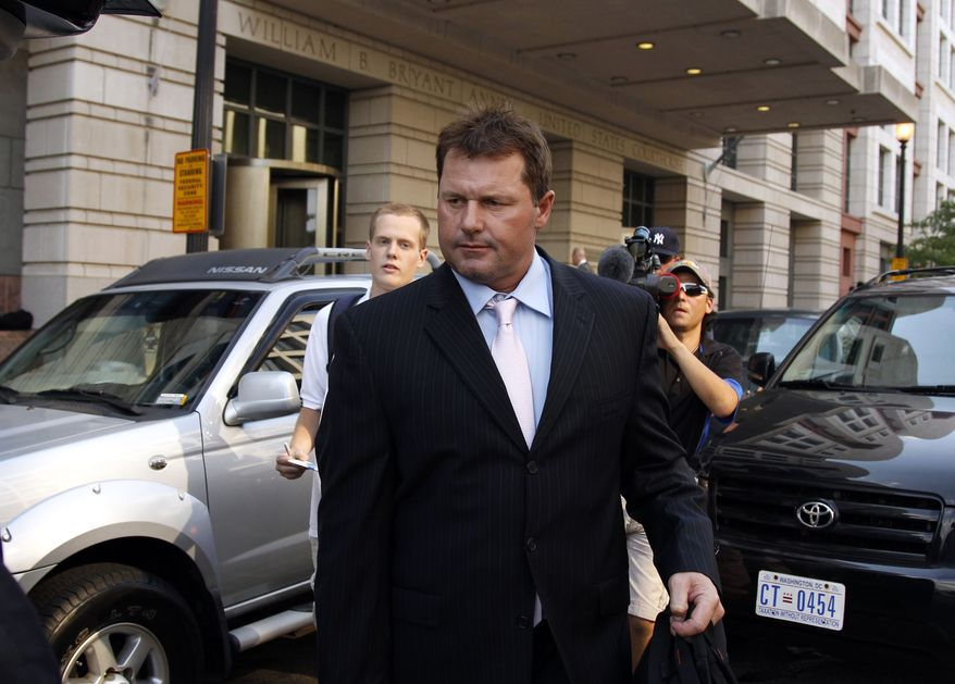 Former Major League Baseball pitcher Roger Clemens leaves federal court on July 12, 2011, in Washington after a day of his trial on charges of lying to Congress in 2008 about using performance-enhancing drugs. (Associated Press)