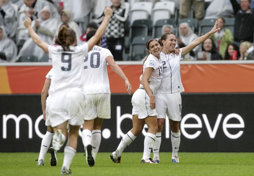 U.S. players celebrate winning the World Cup semifinal match against France 3-1 in Moenchengladbach, Germany on Wednesday. (AP Photo/Yves Logghe)