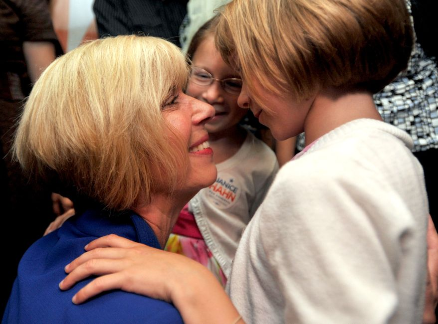 Los Angeles City Councilwoman Janice Hahn, running for California's 36th Congressional District seat, gets hugs and kisses from granddaughters McKenna Yates (left), 8, and Brooklyn Yates, 6, as she addresses the crowd of supporters on Tuesday night, July 12, 2011, at her election party in San Pedro, Calif. (AP Photo/Daily Breeze, Sean Hiller)