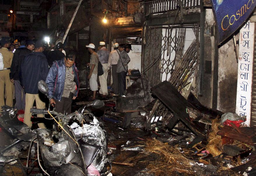 Police inspect the site of an explosion at the Zaveri Bazaar in Mumbai, India, on Wednesday, July 13, 2011. Three blasts rocked India's busy financial capital at rush hour in what officials described as another terror strike on the city, which was hit by militants nearly three years ago. (AP Photo)