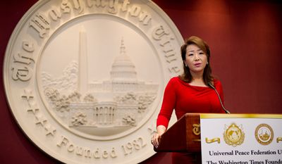 "The Rev. In Jin Moon, president and CEO of the Holy Spirit Association for the Unification of World Christianity, speaks about her own experience with religious persecution Wednesday at a conference, ""Stop Religious Persecution Now."" (Barbara L. Salisbury/The Washington Times)"