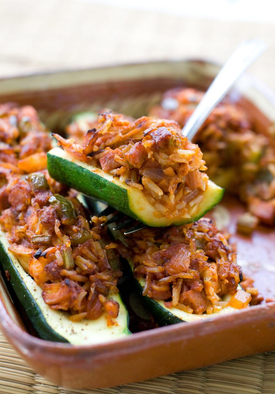 ASSOCIATED PRESS Substituting lean meats for heavier ones reduces calories and fat in jambalaya, which can be put in zucchini, peppers or tomatoes.