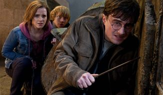 """Emma Watson, Rupert Grint and Daniel Radcliffe are all grown up in """"Harry Potter and the Deathly Hallows — Part 2,"""" the final movie in the wildly popular series about three young wizards who become fast friends in school at Hogwarts. (Warner Bros. Pictures via Associated Press)"""