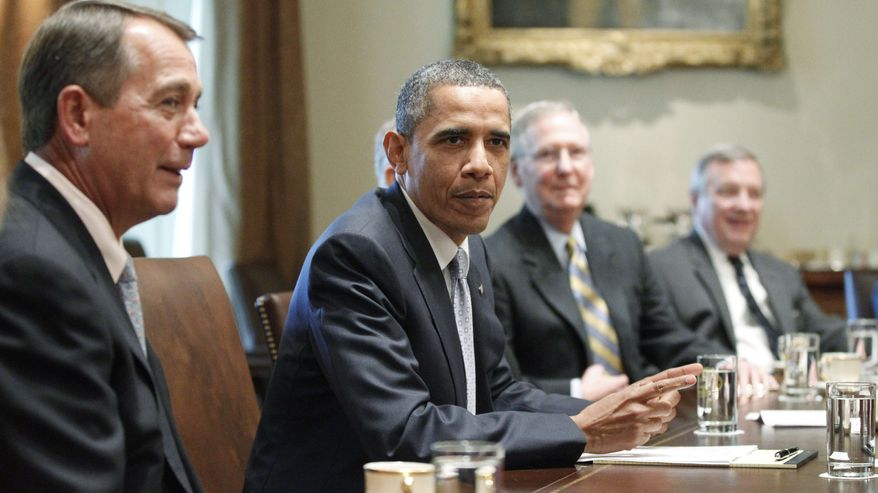 President Obama sits with House Speaker John Boehner (left), Ohio Republican, Senate Minority Leader Mitch McConnell (second from right), Kentucky Republican, and Sen. Dick Durbin, Illinois Democrat, as he meets on July 13, 2011, with Republican and Democratic leaders regarding the debt ceiling in the Cabinet Room of the White House. (Associated Press)