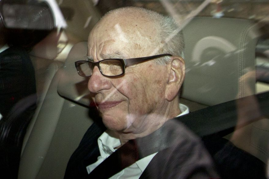 News Corp. Chairman Rupert Murdoch arrives at his residence in central London on Wednesday, July 13, 2011. (AP Photo/Sang Tan)