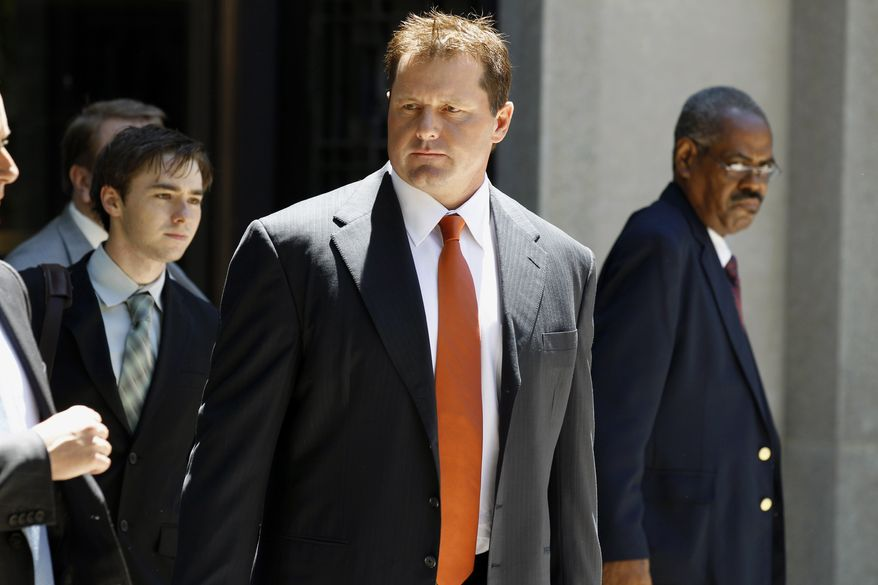 Former Major League Baseball pitcher Roger Clemens (center) leaves federal court in Washington on July 14, 2011, after the judge declared a mistrial in his perjury trial. (Associated Press)