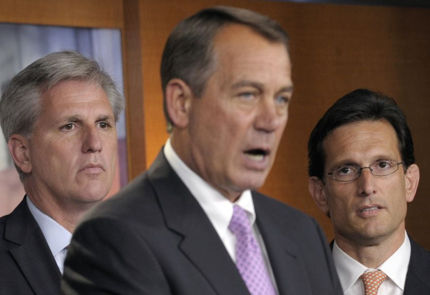 House Majority Leader Eric Cantor (right), Virginia Republican, and House Majority Whip Kevin McCarthy (left), California Republican, listens as House Speaker John Boehner, Ohio Republican, speaks during a news conference on Capitol Hill. (Associated Press)