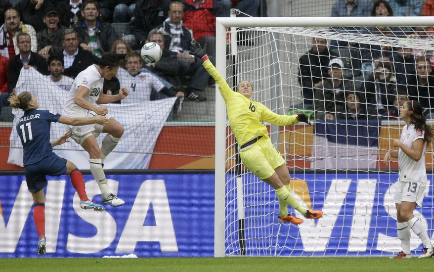 United States' Abby Wambach heads in what proved to be the winning goal for the U.S. against France in the World Cup semifinal. The U.S. won 3-1 and will play Japan on Sunday. (AP Photo/Marcio Jose Sanchez)