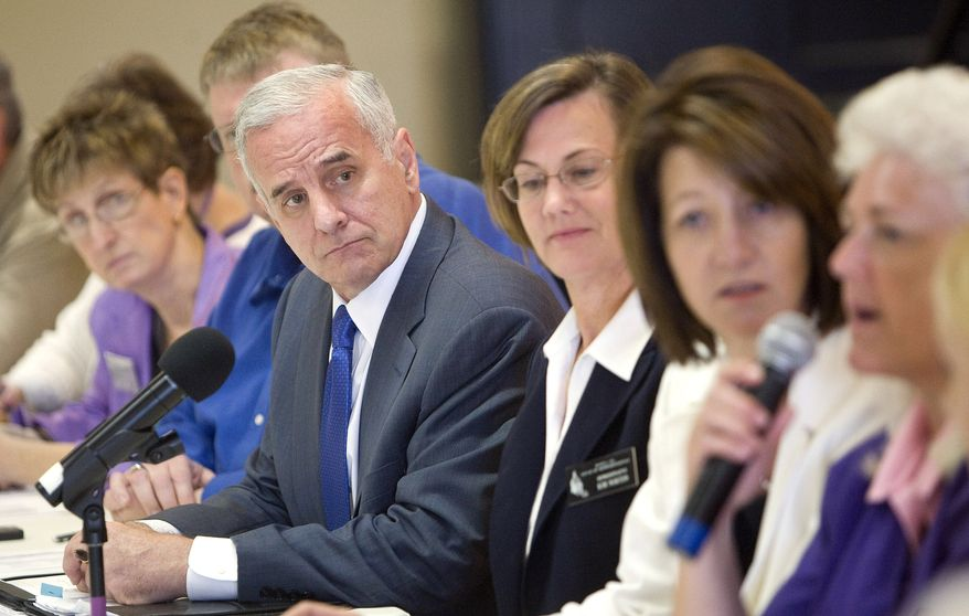 Minnesota Gov. Mark Dayton listens to members of the public explain how state budget cuts would affect them at a roundtable discussion on July 13, 2011 at the Rochester, Minn., Senior Citizen Center. (Associated Press/The Rochester Post-Bulletin)