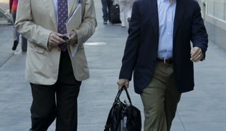 Dallas Cowboys owner Jerry Jones, left, and Kansas City Chiefs owner Clark Hunt arrive at a Manhattan law firm Thursday, July 14, 2011 in New York. The NFL owners and players neared an agreement Thursday on how to rein in the soaring salaries of high first-round picks. (AP Photo/Seth Wenig)
