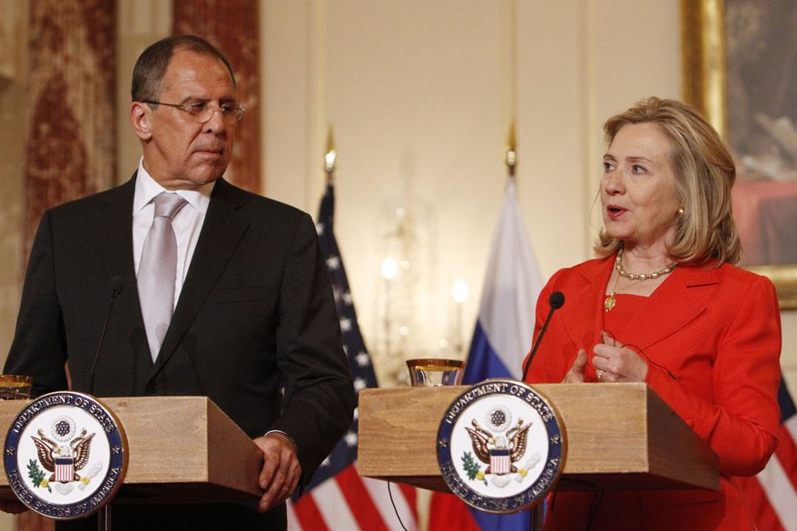 Russian Foreign Minister Sergey Lavrov and Secretary of State Hillary Rodham Clinton participate in a joint briefing at the State Department in Washington on Wednesday, July 13, 2011. (AP Photo/Jacquelyn Martin)
