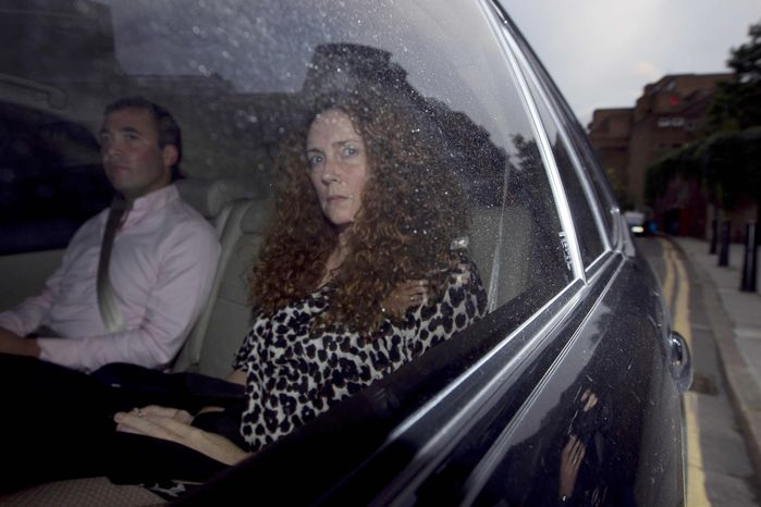 **FILE** Rebekah Brooks, chief executive of News International, is driven away from offices of News International in London, on July 7, 2011. (Associated Press)