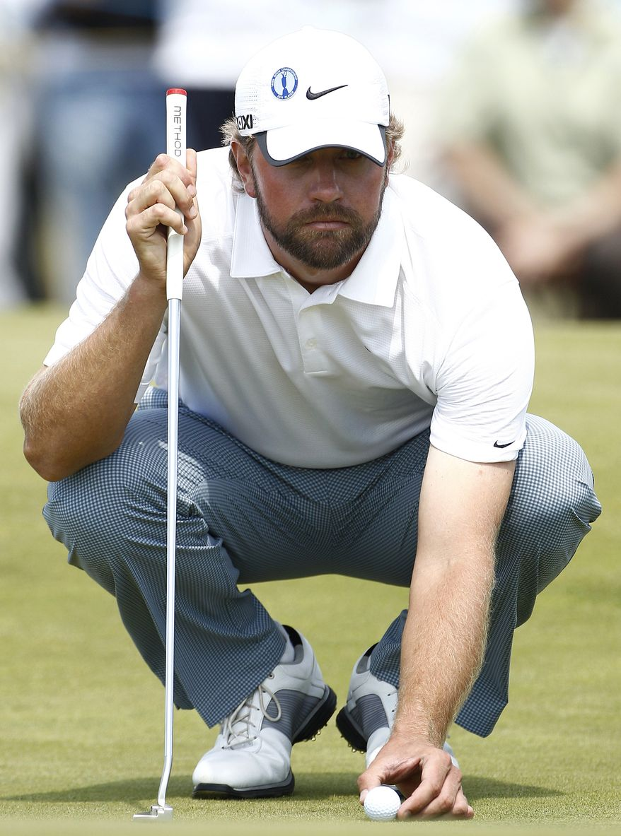 Lucas Glover lines up a putt on the 16th green during the second day of the British Open Golf Championship at Royal St George's golf course on Friday. Glover shot 70 in the second round to reach 4-under 136 for the tournament and shares the lead with Darren Clarke. (AP Photo/Jon Super)