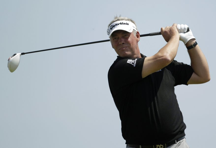 Northern Ireland's Darren Clarke plays a shot off the 18th tee during the second day of the British Open Golf Championship at Royal St George's golf course on Friday. (AP Photo/Peter Morrison)
