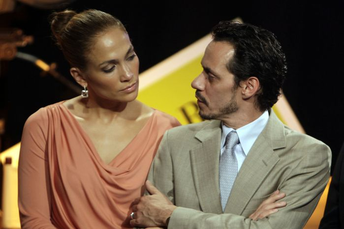In this Friday, March 4, 2011, picture, Jennifer Lopez, left, and husband Marc Anthony attend a signing ceremony for filmmaking incentive legislation for the U.S. island territory in Bayamon, Puerto Rico. The superstar couple announced Friday, July 15, 2011, they are breaking up. The two married in 2004 and have 3-year-old twins, Max and Emme. (AP Photo/Ricardo Arduengo)