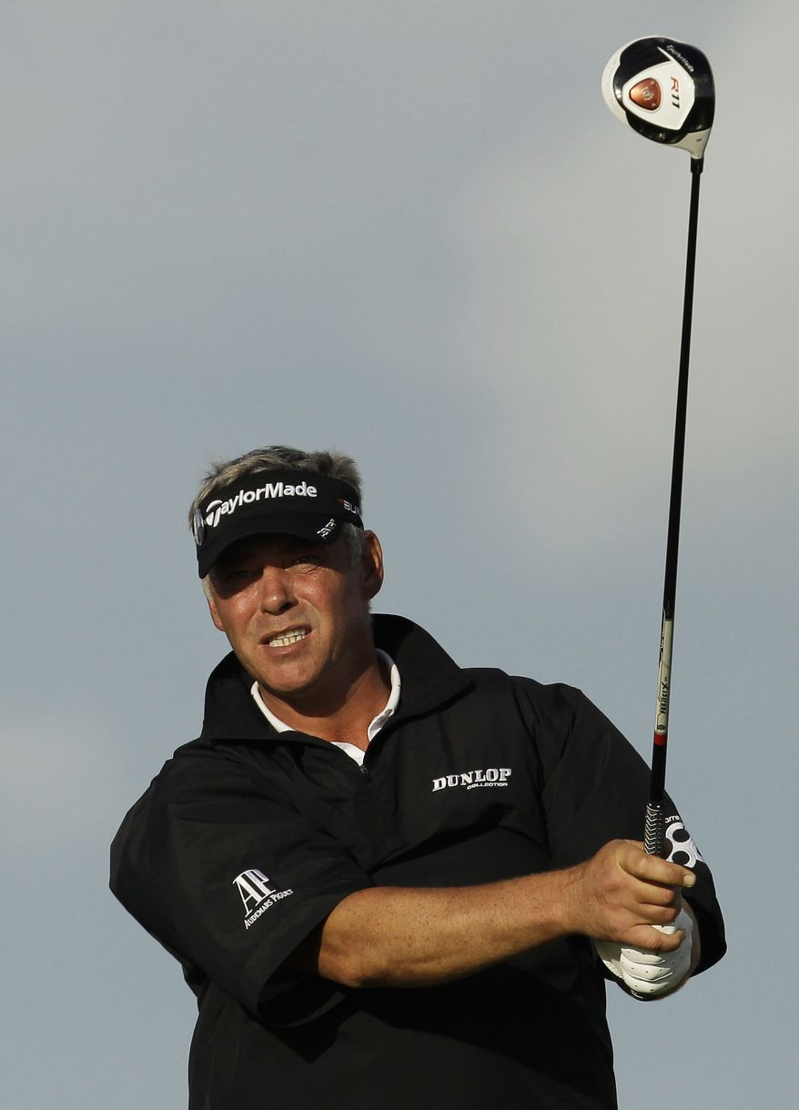 Northern Ireland's Darren Clarke watches his shot off the 18th tee during the third day of the British Open Golf Championship at Royal St George's golf course Saturday. Clarke shot a 1-under 69 and holds a one-stroke lead heading into the final day.(AP Photo/Matt Dunham)