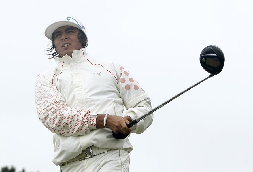 Rickie Fowler of the U.S. plays a shot off the 5th tee during the third day of the British Open Golf Championship at Royal St George's golf course on Saturday. (AP Photo/Jon Super)