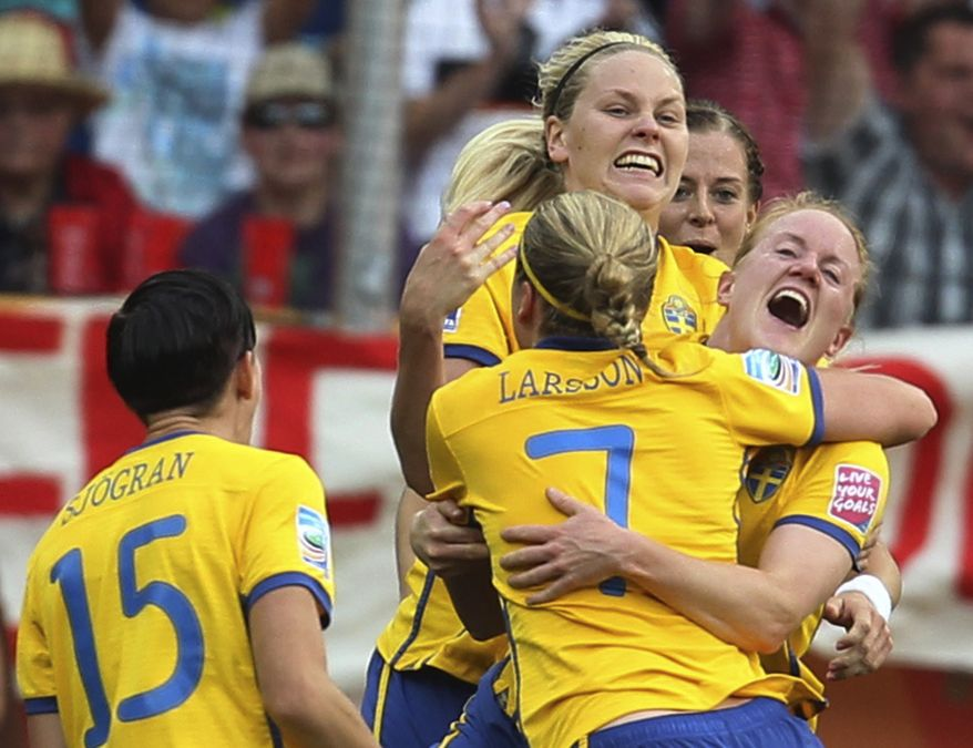 Sweden players celebrate their second goal - and ultimately the winning one - in the 2-1 victory over France in the third-place game at the World Cup. (AP Photo/Michael Probst)