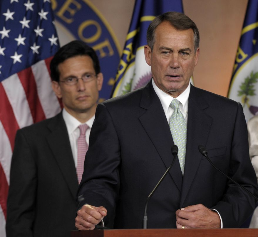 House Speaker John Boehner of Ohio, right, speaks during a news conference with House Majority Leader Eric Cantor, R-Va., left, on Capitol Hill in Washington, Friday, July 15, 2011. (AP Photo/Susan Walsh)