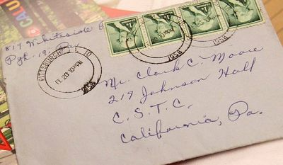 This photo provided by California University of Pennsylvania shows a letter postmarked February 1958 that arrived at the campus mailroom last week. The love letter to a college student is on its way to his current home in Illinois. (Associated Press)