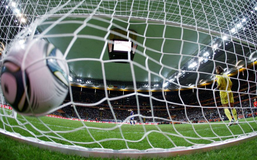 Aya Miyama's decisive goal slams into the net as U.S. goalkeeper Hope Solo watches. (Associated Press)