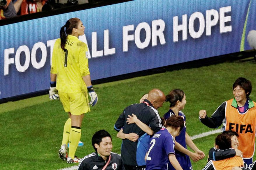 U.S. goalkeeper Hope Solo (left) reacts after Japan won the championship match between Japan and the United States at the Women's Soccer World Cup in Frankfurt, Germany, on Sunday, July 17, 2011. (AP Photo/Michael Sohn)