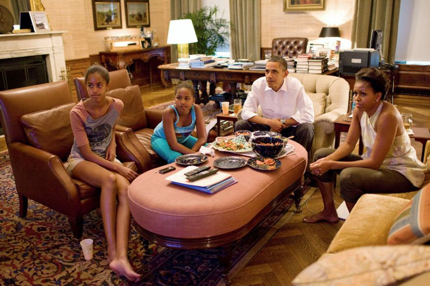 President Obama, first lady Michelle Obama (right) and their daughters, Malia (left) and Sasha, watch the Women's World Cup soccer game between the U.S. and Japan from the Treaty Room at the White House in Washington on Sunday, July 17, 2011. (AP Photo/The White House, Pete Souza)