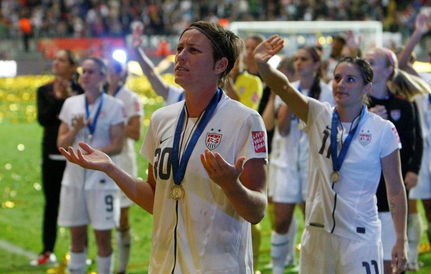 ASSOCIATED PRESS Abby Wambach (front) wants to spend time with her U.S. teammates instead of speculating on her soccer future.