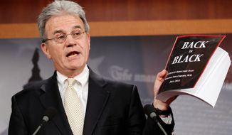 """Sen. Tom Coburn, Oklahoma Republican, offers his """"Back in Black"""" plan to reduce the federal deficit during a news conference Monday. It attempts to explain how to reduce the deficit by more than $900 billion during the next 10 years. (Associated Press)"""
