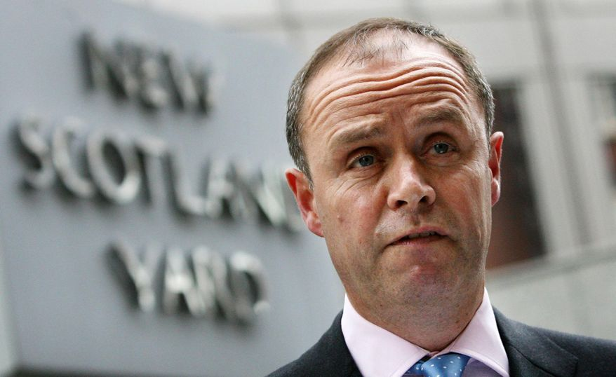 **FILE** In this photo from July 9, 2009, London's Metropolitan Police Assistant Commissioner John Yates stands outside the force's headquarters at New Scotland Yard in London. (Associated Press)