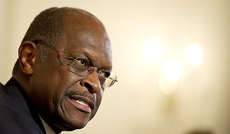 **FILE** Republican presidential candidate Herman Cain speaks July 18 2011, with reporters and editors during an interview at The Washington Times' office building in D.C. (Rod Lamkey Jr./The Washington Times)