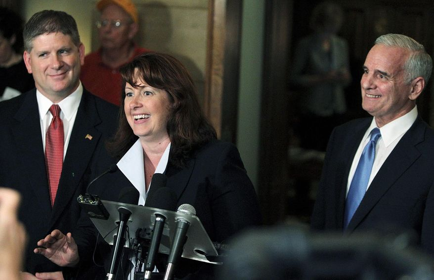 Smiles were bipartisan at a news conference outside the office of Minnesota Gov. Mark Dayton (right), a Democrat, in St. Paul, Minn., Tuesday as Republican leaders Sen. Amy Koch and Speaker of the House Kurt Zellers joined Mr. Dayton in announcing a special legislative session aimed at getting a budget passed and ending a partial government shutdown. (AP Photo/Minneapolis Star Tribune)
