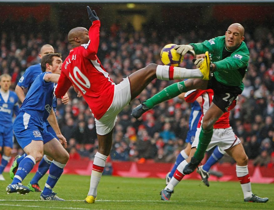 ASSOCIATED PRESS PHOTOGRAPHS Tim Howard (above), a New Jersey native, established himself as a force overseas, being named the English Premier League's top goalkeeper with Manchester United in 2003-04. He was a fiery presence (top) for the U.S. during the World Cup in 2010.
