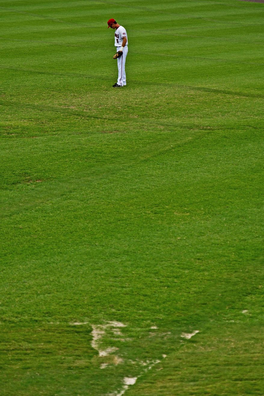 Potomac Nationals outfielder J.R. Higley mans right field at Pfitzner Stadium in Woodbridge, Va., where there are bald spots in the grass. Too much water also has been problematic this season. (Drew Angerer/The Washington Times)