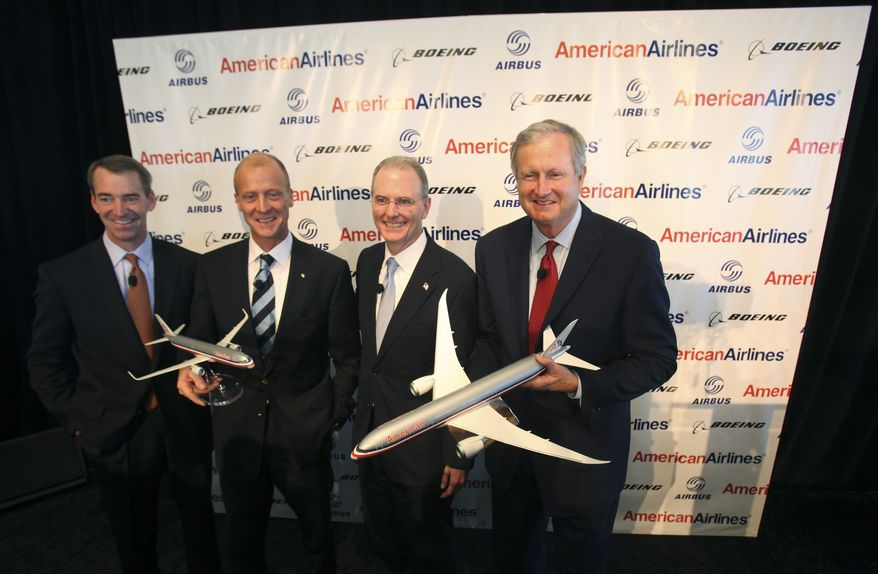 Posing for photos after a news conference from right are Jim Albaugh, president and CEO of Boeing Commercial Airplanes; Gerard J. Arpey, president and CEO of AMR Corporation; Thomas Enders, CEO of Airbus and Tom Horton, president of American Airlines at Dallas-Fort Worth International airport in Grapevine, Texas Wednesday, July 20, 2011. American Airlines is buying at least 460 new planes over the next five years in the biggest single passenger jet order in history. American will buy 260 planes from Airbus and 200 from Boeing. (AP Photo/LM Otero)