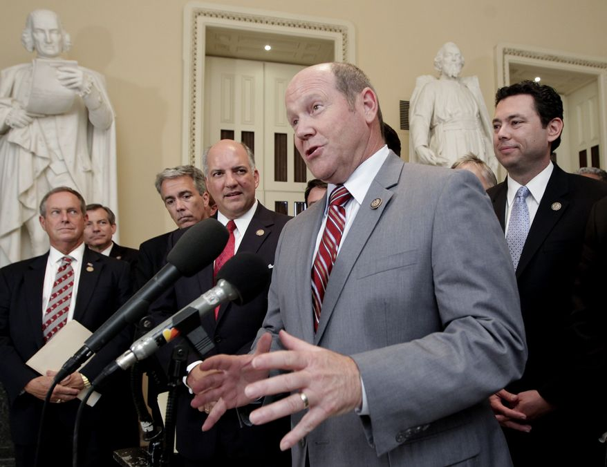 """Rep. Reid J. Ribble, Wisconsin Republican, and other House GOP members speak about the passage of the conservative deficit reduction plan known as """"cut, cap and balance"""" at the Capitol in Washington on Tuesday, July 19, 2011. (AP Photo/J. Scott Applewhite)"""