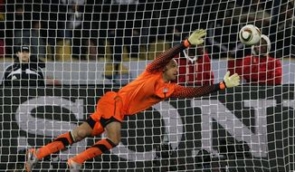 United States goalkeeper Tim Howard makes a save during the World Cup group C soccer match between England and the United States in South Africa. (AP Photo/Elise Amendola)